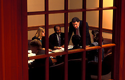 Stock photo of a corporate business meeting inside of a conference room