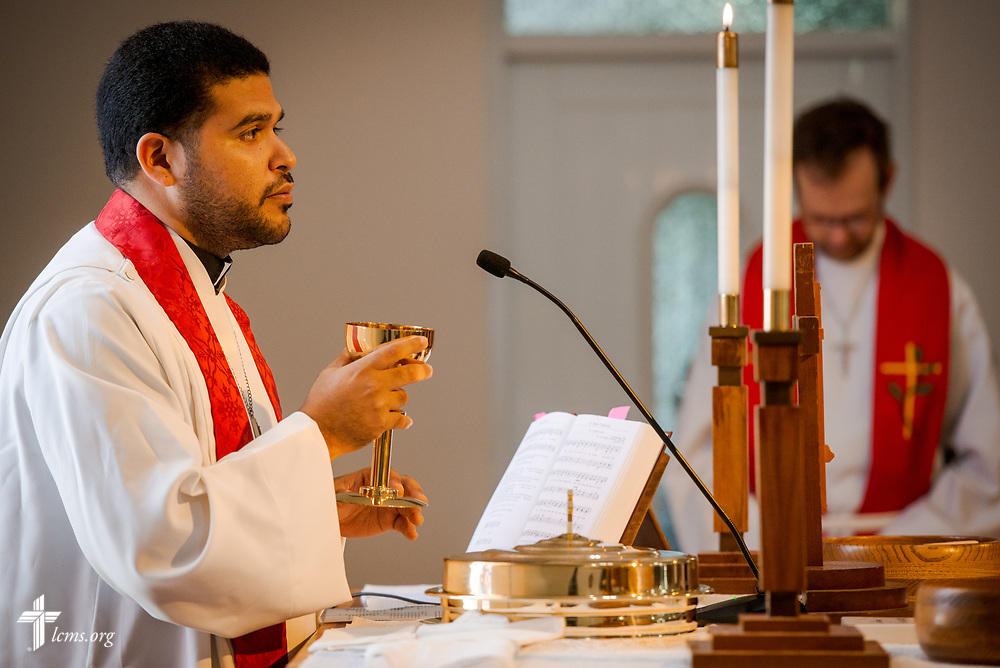 The Rev. Gustavo Maita, pastor of Iglesia Luterana Principe de Paz (Prince of Peace Lutheran Church), Mayagüez, Puerto Rico, leads worship with the Words of Institution for the Lord's Supper on Sunday, April 15, 2018. LCMS Communications/Erik M. Lunsford