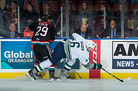 KELOWNA, CANADA - OCTOBER 10: Nolan Foote #29 of the Kelowna Rockets checks Tyrel Bauer #6 of the Seattle Thunderbirds at the boards on October 10, 2018 at Prospera Place in Kelowna, British Columbia, Canada.  (Photo by Marissa Baecker/Shoot the Breeze)  *** Local Caption ***
