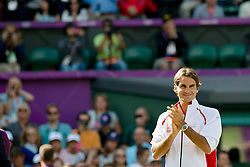 05.08.2012, Wimbledon, London, GBR, Olympia 2012, Tennis, Herren Finale, im Bild Roger Federer (SUI) an der Siegerehrung // during Tennis Mens Final, at the 2012 Summer Olympics at Wimbledon, London, United Kingdom on 2012/08/05. EXPA Pictures © 2012, PhotoCredit: EXPA/ Freshfocus/ Valeriano Di Domenico..***** ATTENTION - for AUT, SLO, CRO, SRB, BIH only *****