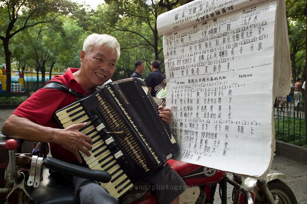 Street musician in Lu Xun Park, Shanghai, China.