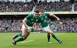 Ireland's Jacob Stockdale scores a try during the NatWest Six Nations match at the Aviva Stadium, Dublin.