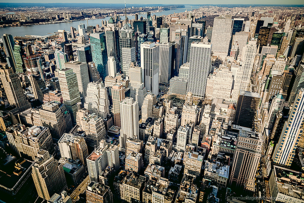 January 2006, New York City, USA: A wide angle view of Manhatten Rooftops from the Empire State Building looking towards The upper west side of Manhatten Island and the river. Also Visible is the long shadow of the Empirte state Building