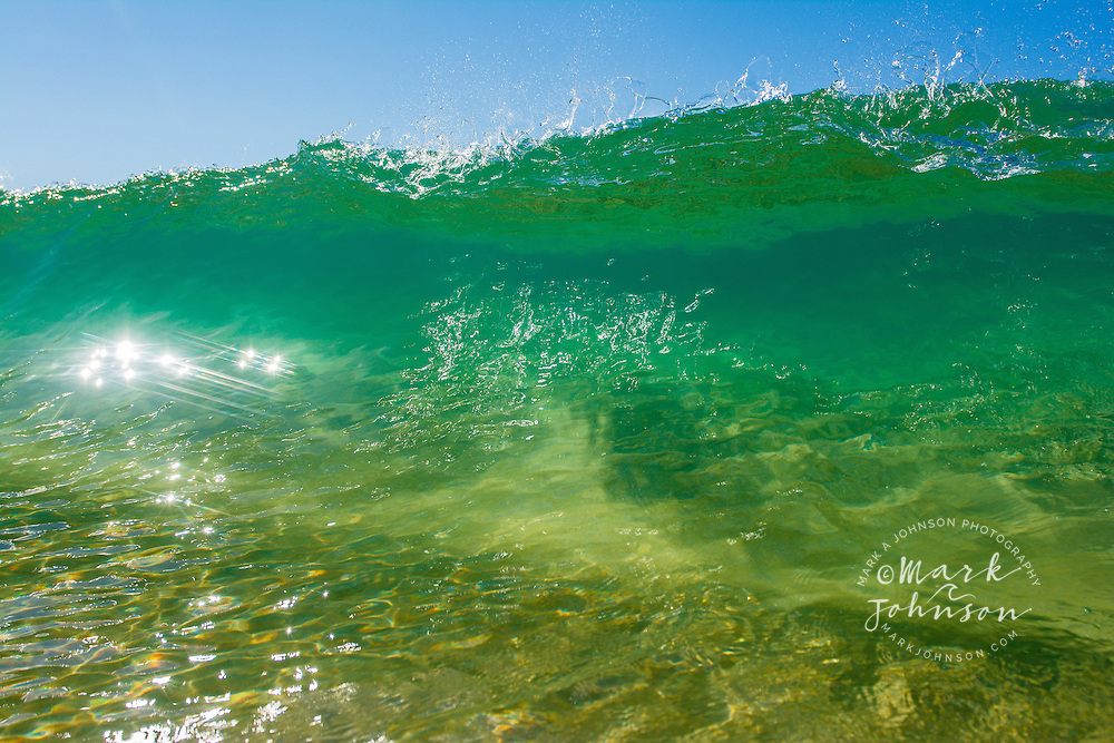 A crystal clear wave in sunny Queensland Australia
