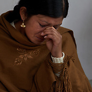 Cholita Yolanda La Amorosa reacts while discussing her relationship with her father, a former wrestler, during interview. Yolanda is a member of the 'Titans of the Ring' wrestling group who perform every Sunday at El Alto's Multifunctional Centre. Bolivia. The wrestling group includes the fighting Cholitas, a group of Indigenous Female Lucha Libra wrestlers who fight the men as well as each other for just a few dollars appearance money. El Alto, Bolivia, 24th March 2010. Photo Tim Clayton