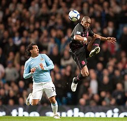 24.03.2010, City of Manchester Stadium, Manchester, ENG, PL, Manchester City FC vs Everton FC im Bild Everton's Sylvain Distin and Manchester City's Carlos Tevez, EXPA Pictures © 2010, PhotoCredit: EXPA/ Propaganda/ D. Rawcliffe / SPORTIDA PHOTO AGENCY