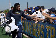 Aug 6, 2018; Costa Mesa, CA, USA: Los Angeles Chargers defensive end Darius Philon (93) is greeted by fans during training camp at the Jack. R. Hammett Sports Complex.