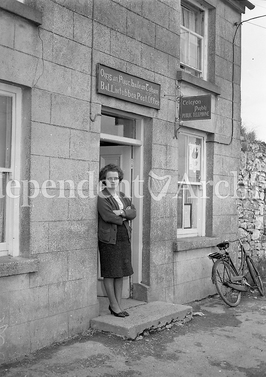 Post Mistress outside post office in Ballintubber, Co. Roscommon. September 10 1964. <br />