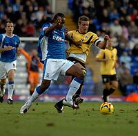 Photo: Ian Hebden.<br />Birmingham City v Barnsley. Coca Cola Championship. 11/11/2006.<br />Birmingham's Cameron Jerome (L) takes on Barnsleys Paul Reid (R).