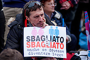 """Rome jan 30th 2016, people gather at Rome's Circus Maximus. Thousands of people were gathering in Rome's Circus Maximus for a pro-family protest that opposes proposed legislation permitting civil unions for same-sex couples and legal recognition for their families. In the picture protester with a banner: """"wrong is wrong"""""""
