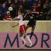 Kenny Cooper, Red Bulls, challenges Robbie Russell, D.C. United during the New York Red Bulls V D.C. United Major League Soccer, Eastern Conference Semi Final 2nd Leg match at Red Bull Arena, Harrison. New Jersey. USA. 8th November 2012. Photo Tim Clayton