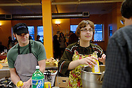 Canada, Ontario, Kitchener. February 2, 2008. Staff and volunteers prepare a meal for a volunteers' appreciation evening at the Working Centre's St. John's Kitchen. The Working Centre is a volunteer inspired organisation that provides individuals and groups certain tools for community  building.