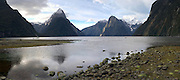 Low-angle panoramic Sunset view of Milford Sound (Piopiotahi), Stirling Falls and Mount Pembroke, Fiordland National Park, New Zealand