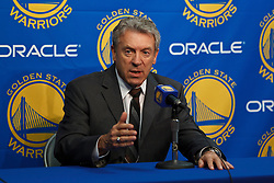Mar 16, 2012; Oakland, CA, USA; Golden State Warriors general manager Larry Riley introduces center Andrew Bogut (not pictured) before the game against the Milwaukee Bucks at Oracle Arena.  Milwaukee defeated Golden State 120-98. Mandatory Credit: Jason O. Watson-US PRESSWIRE