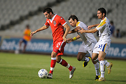 Nicosia, Cyprus - Saturday, October 13, 2007: Wales' Joe Ledley in action against Cyprus' Chrysostomous Michail and Marios Nicolau during the Group D UEFA Euro 2008 Qualifying match at the New GSP Stadium in Nicosia. (Photo by David Rawcliffe/Propaganda)
