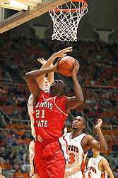02 January 2004  Marcus Arnold gets inside of the big guy. Illinois State University ties up The Fightin Illini in regulation but fails to top the Big 10 team in overtime. Action took place at the Assembly Hall on the University of Illinois Campus in Champaign - Urbana Illinois.