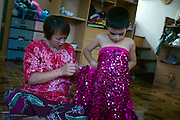 "Kafille is 6 years old. His mother had noticed since he was 3 years old, he already behaved as a little girl, showing signs of being feminine. His older brother, Aekachai, 23, is a ladyboy, and Kafille was definitely influenced by him..As her mother said: ""we can't do anything, he has to follow his heart and has to live his life the way he wants to"""