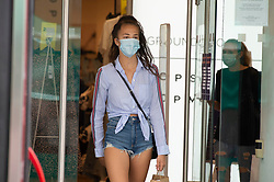 ©Licensed to London News Pictures 24/07/2020     <br /> Bromley, UK. A shopper coming out of Topshop in Bromley High Street, South East London today wearing a face mask. A face mask or covering becomes compulsory from today when entering a petrol station, shop, train station, bank, post office or a shopping centre. The new rule is to help in the fight against coronavirus. Photo credit: Grant Falvey/LNP