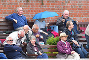 An umbrella is up in the crowd as light drizzle falls during the opening day of the Specsavers County Champ Div 1 match between Somerset County Cricket Club and Surrey County Cricket Club at the Cooper Associates County Ground, Taunton, United Kingdom on 18 September 2018.