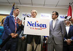 October 1, 2018 - Orlando, FL, USA - Congressman Darren Soto, left, watches as Senator Bill Nelson speaks after picking up the endorsement of Puerto Rican Governor Ricardo Rossello, right, for Nelson's re-election bid for Senate during a press conference in Orlando on Monday morning, Oct. 1, 2018. (Credit Image: © Jacob Langston/Orlando Sentinel/TNS via ZUMA Wire)