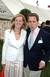 JACK CHURCHILL and his fiance CHARLOTTE BABER at the 2004 Cartier International polo day at Guards Polo Club, Windsor Great Park, Berkshire on 25th July 2004.
