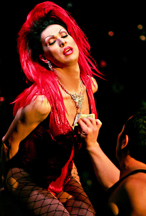 """Anastasia"" is tipped during a performance at the Albuquerque Social Club on Sept. 22, 2007. (Xavier Mascareñas)"