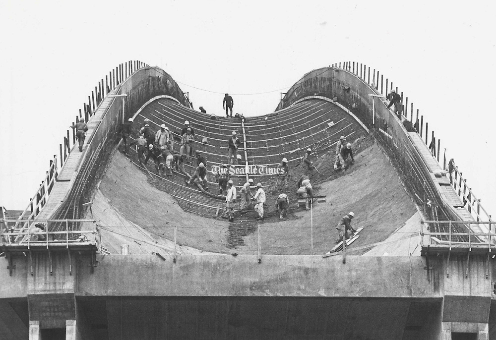 Workmen pour concrete on the first of the 40 ribs which will form the dome of the King County Stadium. (Bruce McKim /The Seattle Times, 1974)