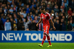 Bayern Defender Jerome Boateng (GER) leaves the field after a is shown a red card by card from referee Bjorn Kuipers (NED) during the second half of the match - Photo mandatory by-line: Rogan Thomson/JMP - Tel: Mobile: 07966 386802 - 02/10/2013 - SPORT - FOOTBALL - Etihad Stadium, Manchester - Manchester City v Bayern Munich - UEFA Champions League Group D.
