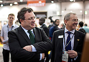 ..Dr. Stephen Farry Employment and Learning Minister for Northern Ireland the ExCel Centre with entourage  in London on October 8th 2011.