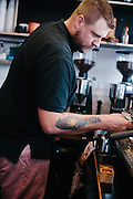 Coffee Barista, Tattoo Arm of Coffee Barista, Coffee Barista at work, Melbourne Coffee Barista,