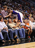 Nov. 23, 2012; Phoenix, AZ, USA; Phoenix Suns forward P.J. Tucker (17) is caught by a fan as he dives for the ball during the game against the New Orleans Hornets in the second half at US Airways Center. The Suns defeated the Hornets 111-108 in overtime. Mandatory Credit: Jennifer Stewart-US PRESSWIRE