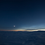 Wide angle landscape of the final seconds of totality as the light returns on the right and the eclipse prepares to lift, bringing light back to the ice and snow of Svalbard, Norway, 20 March 2015
