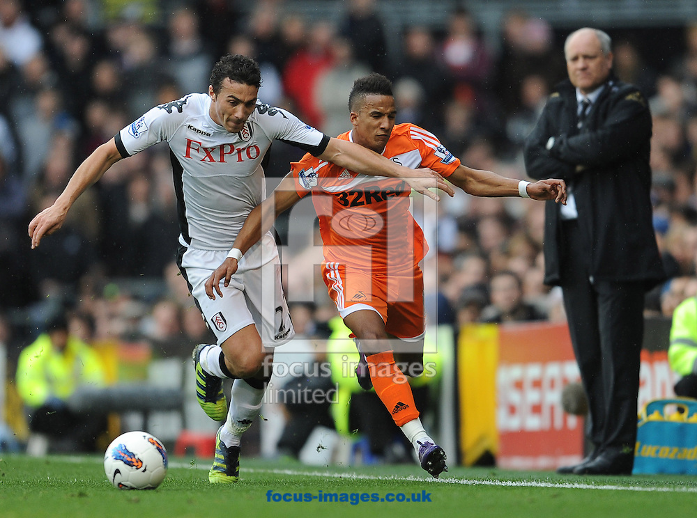 Picture by Andrew Timms/Focus Images Ltd. 07917 236526.17/03/12.Stephen Kelly of Fulham and Scott Sinclair of Swansea City during the Barclays Premier League match at Craven Cottage stadium, London.