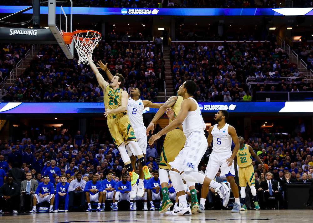 Mar 28, 2015; Cleveland, OH, USA; Notre Dame Fighting Irish guard/forward Pat Connaughton (24) goes to the basket on Kentucky Wildcats guard Aaron Harrison (2) in the finals of the midwest regional of the 2015 NCAA Tournament at Quicken Loans Arena. Mandatory Credit: Rick Osentoski-USA TODAY Sports