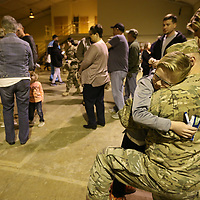 Grayson Alexander, 9, of New Albany gives gives dad, Jacob, one last hug before he boards a bus with the rest of the members of the 155th Headquarters Headquarters Company as they leave for training at Fort Bliss. After training the entire 155th Brigade ombat Team will delpoy to various parts of the Middle East.