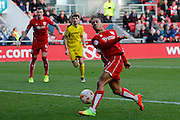 Bristol City midfielder Bobby Reid (14) scuffs a shot and sees it saved by Burton Albion goalkeeper Jon McLaughlin (1)  during the EFL Sky Bet Championship match between Bristol City and Burton Albion at Ashton Gate, Bristol, England on 4 March 2017. Photo by Richard Holmes.
