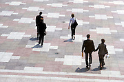 business professionals walking on urban courtyard