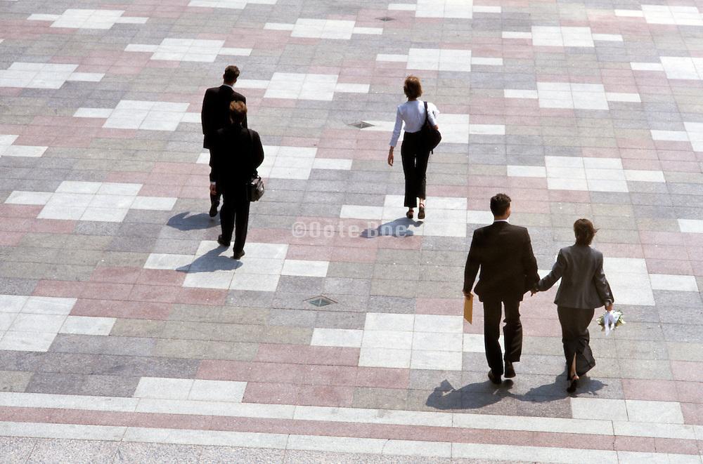 business professionals walking on urban courtyard