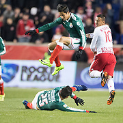 HARRISON, NEW JERSEY- APRIL 10:  Carlos Cisneros #24 of C.D. Guadalajara jumps over team mate Michael Perez #25 of C.D. Guadalajara  while challenged by Alejandro Romero Gamarra #10 of New York Red Bulls during the New York Red Bulls Vs C.D. Guadalajara CONCACAF Champions League Semi-final 2nd leg match at Red Bull Arena on April 10, 2018 in Harrison, New Jersey. (Photo by Tim Clayton/Corbis via Getty Images)