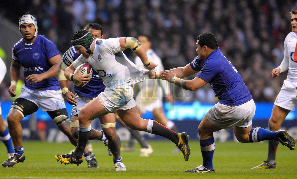 © SPORTZPICS / SECONDS LEFT IMAGES 2010 - Rugby Union - Investec Challenge - England v Samoa - 20/11/10 - England's Hendre Fourie  on the charge tries to avoid Samoa's Ofisa Treviranus jersey pull - at Twickenham Stadium UK - All rights reserved