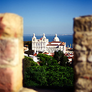 View from the ramparts of Castelo de Sao Jorge, Lisbon, Portugal. The dome in the distance is São Vicente de Fora, while the two towers in front of it are from the Igreja Paroquial de Sao Vicente de Fora
