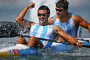 Argentina's Miguel Antonio Correa (L) and Ruben Oscar Voisard Rezola (R) react on the finnish line of the Kayak Double (K2) 200m Men's Canoe Sprint Semi-finals