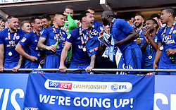 Cardiff City Captain Sean Morrison (centre) and Sol Bamba (fourth from right) celebrate winning their promotion to the Premier League after the Sky Bet Championship match at the Cardiff City Stadium.
