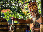 16 JULY 2016 - UBUD, BALI, INDONESIA: A Brahmin Hindu priest leads a prayer service before the mass cremation in Ubud Saturday. Local people in Ubud exhumed the remains of family members and burned their remains in a mass cremation ceremony Wednesday. Almost 100 people were cremated and laid to rest in the largest mass cremation in Bali in years this week. Most of the people on Bali are Hindus. Traditional cremations in Bali are very expensive, so communities usually hold one mass cremation approximately every five years. The cremation in Ubud concluded Saturday, with a large community ceremony.     PHOTO BY JACK KURTZ