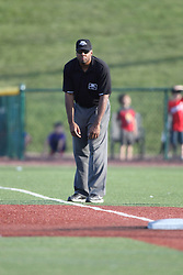 24 July 2015:  Umpire Joe Harris during a Frontier League Baseball game between the Gateway Grizzlies and the Normal CornBelters at Corn Crib Stadium on the campus of Heartland Community College in Normal Illinois