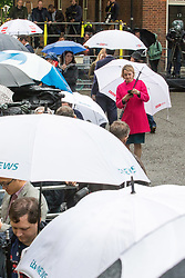 London, June 9th 2017. A rain shower sees umbrellas unfurled as the world's media gather outside 10 Downing Street in London, official residence of the British Prime Minister Theresa May who is expected at some point in the day to make a statement following the hung Parliament result that sees the Tories' majority of 17 seats cut to nothing.