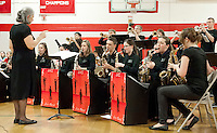 Laconia High School's Music Teacher Debbie Gibson along with the LHS jazz band during Tuesday evening's Spring Concert.  (Karen Bobotas/for the Laconia Daily Sun)