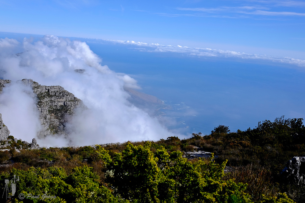 Cape Town, South Africa. Cloud formations seen from the top of Table Mountain looking towards Camps Bay