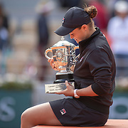 PARIS, FRANCE June 08.  Ashleigh Barty of Australia with the trophy after her victory against Marketa Vondrousova of the Czech Republic on Court Philippe-Chatrier during the Women's Singles Final match at the 2019 French Open Tennis Tournament at Roland Garros on June 8th 2019 in Paris, France. (Photo by Tim Clayton/Corbis via Getty Images)