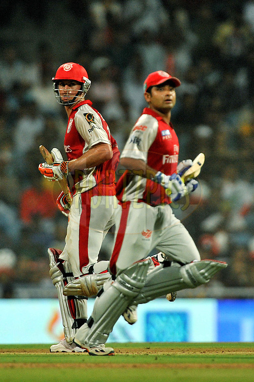 Piyush Chawla of Kings XI Punjab and Ryan Mclaren of Kings XI Punjab run between the wicket during  match 5 of the Indian Premier League ( IPL ) Season 4 between the Pune Warriors and the Kings X1 Punjab held at the Dr DY Patil Sports Academy, Mumbai India on the 9th April 2011..Photo by Pal Pillai/BCCI/SPORTZPICS